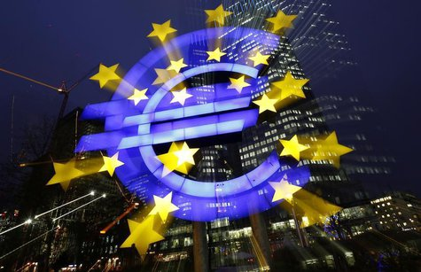 An illuminated euro sign is seen in front of the headquarters of the European Central Bank (ECB) in the late evening in Frankfurt January 8,