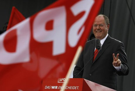Peer Steinbrueck, the Social Democratic party (SPD) candidate in the upcoming general elections, gestures while delivering a speech at his p