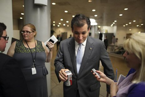 U.S. Senator Ted Cruz (R-TX) (C) talks with a reporter after the weekly Republican caucus luncheon at the U.S. Capitol in Washington, June 2