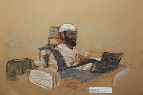 Saudi Mustafa al Hawsawi appears at his arraignment as an accused 9/11 co-conspirator in this courtroom sketch reviewed and approved for rel