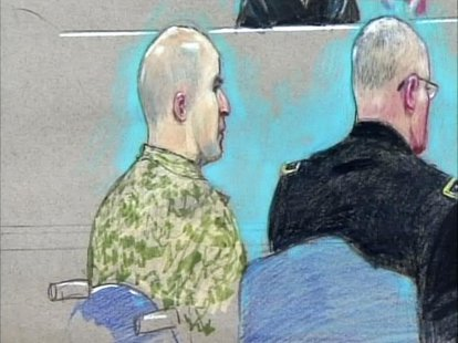 U.S. Army Major Nidal Malik Hasan (L) appears before the Fort Hood Chief Circuit Judge Colonel Gregory Gross with a military lawyer (R) duri