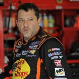 NASCAR Sprint Cup Series driver Tony Stewart, of the number 14 car, speaks with crew members in the garage during practice for the Daytona 5