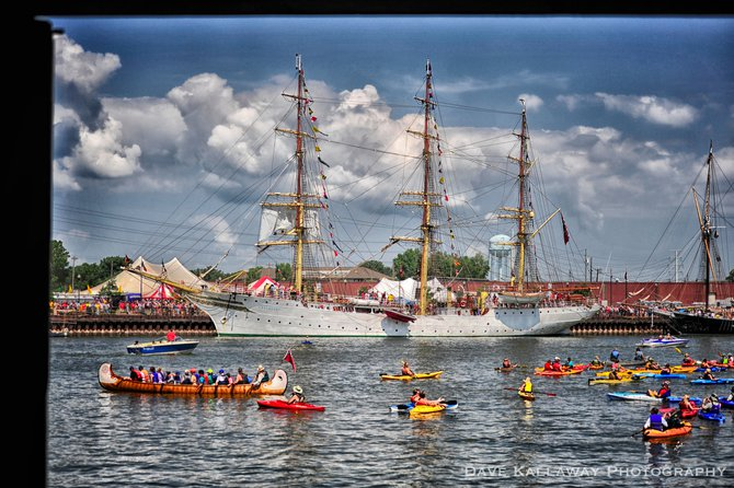 Kayaks help show you just how big these Tall Ships are...