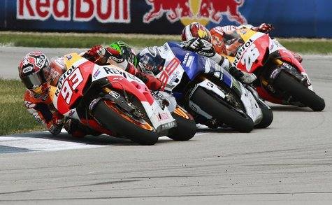 Honda MotoGP rider Marc Marquez (93) leads Yamaha rider Jorge Lorenzo (99) and Honda rider Dani Pedrosa, all of Spain, during the Indianapol