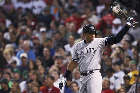 New York Yankees Alex Rodriguez warms up on deck in the first inning of their MLB American League Baseball game against the Boston Red Sox i