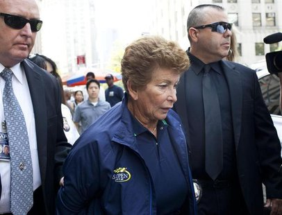 Lois Ann Goodman, 70, is led away from the Manhattan Criminal Court after being extradited to California in the custody of Los Angeles Polic