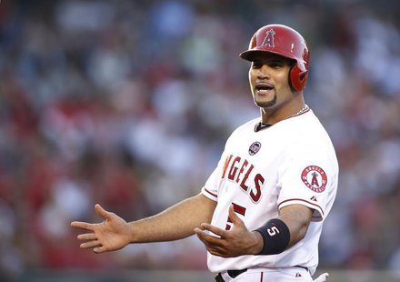 Los Angeles Angels' Albert Pujols gestures towards the New York Yankees dugout after hitting a single during the first inning of their MLB A