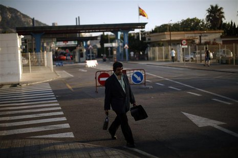 A man leaves the British territory of Gibraltar at its border with Spain, in la Linea de la Concepcion, southern Spain August 19, 2013. REUT