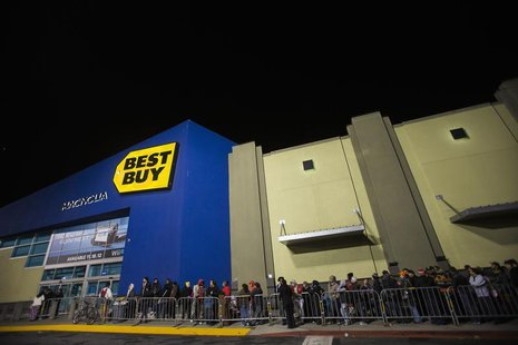 Holiday shoppers wait outside Best Buy in preparation for Black Friday shopping during Thanksgiving Day in San Francisco, California Novembe