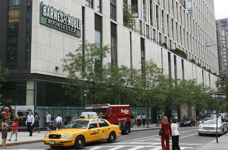 People walk past the Barnes and Noble bookstore on the corner of Warren and Greenwich street in New York June 29, 2010. REUTERS/Lily Bowers