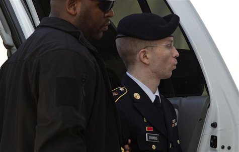 U.S. Army Pfc. Bradley Manning arrives at the courthouse during his court martial at Fort Meade in Maryland August, 20, 2013. REUTERS/Jose L