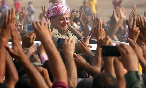 Iraqi Kurdish President Massoud Barzani (C) visits Syrian refugees at the Quru Gusik refugee camp in Arbil, about 350 km (220 miles) north o