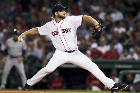 Boston Red Sox starting pitcher Ryan Dempster opens against the New York Yankees during their MLB American League Baseball game in Boston, M