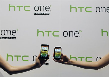New HTC smartphones HTC One X+ (L) and HTC One S Special Edition are presented during a news conference for the launch of the products in Ta