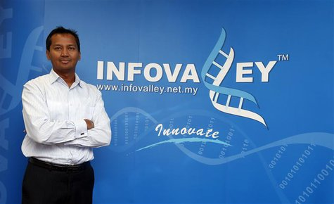 Infovalley Group Chief Executive Mathavan Chandran poses at his office in Kuala Lumpur, in this picture taken June 24, 2013. REUTERS/Bazuki