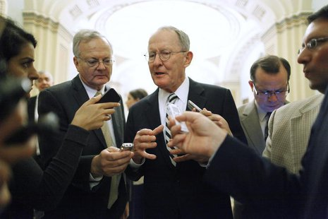 U.S. Senator Lamar Alexander (R-TN) (C) talks with reporters following the weekly Republican caucus luncheon at the U.S. Capitol in Washingt
