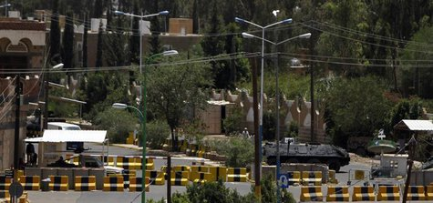 A general view shows the concrete barriers at the entrance to the U.S. embassy in Sanaa August 7, 2013. REUTERS/Mohamed al-Sayaghi