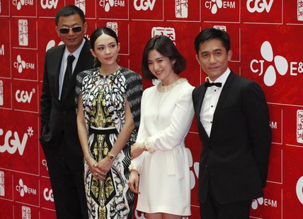 (L-R) Director Wong Kar-wai and cast members Zhang Ziyi , Song Hye-kyo and Tony Leung Chiu-wai pose for photographers during an event promot