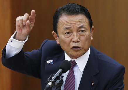 Japan's Finance Minister Taro Aso speaks during a semi-annual parliament hearing on monetary policy at the Lower House of the parliament in