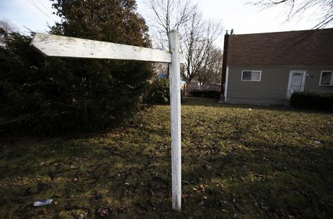 "An empty post where a ""for sale"" sign used to hang is seen outside a home in Brentwood, New York February 10, 2012. REUTERS/Shannon Stapleto"