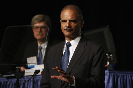 U.S. Attorney General Eric Holder speaks on stage during the annual meeting of the American Bar Association in San Francisco, California Aug
