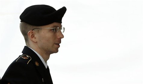 U.S. soldier Bradley Manning is escorted into court to receive his sentence at Fort Meade in Maryland August 21, 2013. REUTERS/Kevin Lamarqu