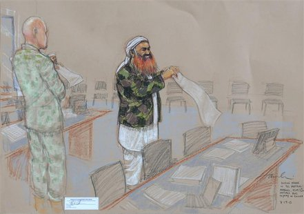 In this photo of a sketch by courtroom artist Janet Hamlin and reviewed by the U.S. Department of Defense, Khalid Sheikh Mohammed unfurls a