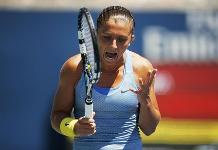 Sara Errani of Italy reacts to missing a point against Agnieszka Radwanska of Poland during their women's quarter-finals tennis match of the