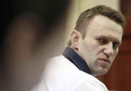 Russian opposition leader and anti-corruption blogger Alexei Navalny looks on during a break in a court hearing in Kirov July 2, 2013. REUTE