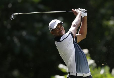 Tiger Woods of the U.S. tees off on the third hole during the third round of the 2013 PGA Championship golf tournament at Oak Hill Country C