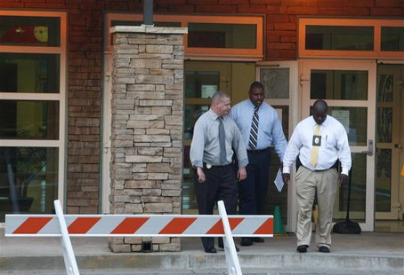 Police investigators are at the front entrance of McNair Discovery Learning Academy after a shooting incident in Decatur, Georgia, August 20