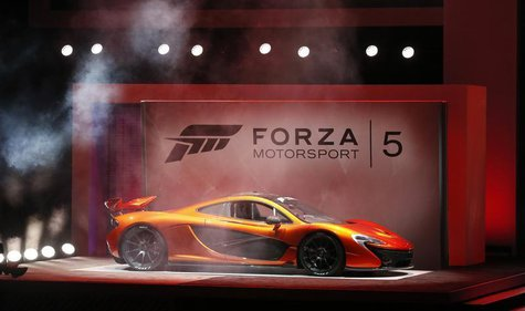 "A McLaren P1 is showcased during a presentation for the game ""Forza Motorsport 5"" during the Xbox E3 Media Briefing at USC's Galen Center in"