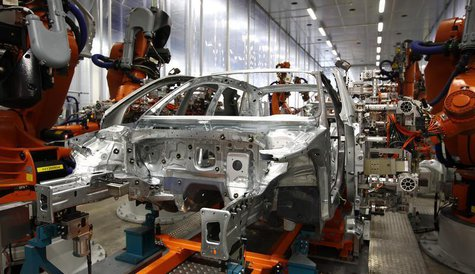 Robots connect side parts on an Audi A3 light weight construction chassis at the production line of the German car manufacturer's plant in t