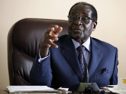 Zimbabwe's President Robert Mugabe gestures while addressing a meeting of his ZANU PF party's supreme decision making body in Harare August