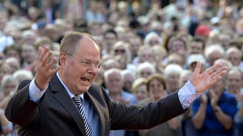 Social Democratic top candidate Peer Steinbrueck (SPD) raises his arms during his speech at an election campaign in Hanover, August 21, 2013