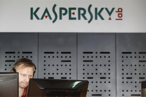 An employee works near screens in the virus lab at the headquarters of Russian cyber security company Kaspersky Labs in Moscow July 29, 2013