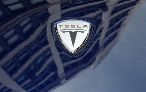 A logo of Tesla Motors on an electric car model is seen outside a showroom in New York June 28, 2010. REUTERS/Shannon Stapleton