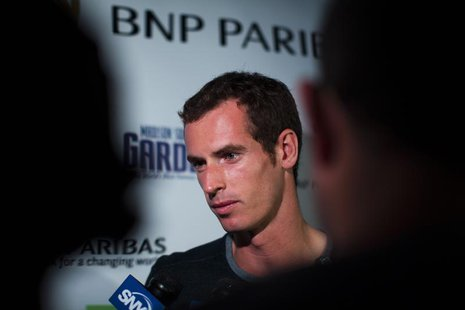 Tennis player Andy Murray of Britain speaks with the media as he attends an event announcing his participation in the 7th annual BNP Paribas