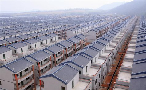A general view of newly built houses at Dadun village of Lingshui ethnic Li Autonomous County, Hainan province, in this January 18, 2013 fil