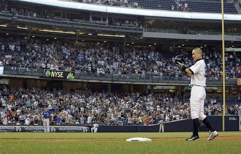 New York Yankees right fielder Ichiro Suzuki tips his cap to the crowd after he singled against the Toronto Blue Jays for his 4000th profess