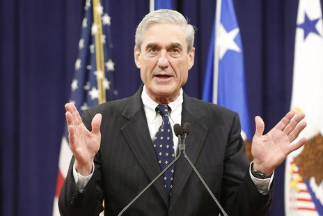 Outgoing FBI Director Robert Mueller reacts to applause from the audience during his farewell ceremony at the Justice Department in Washingt