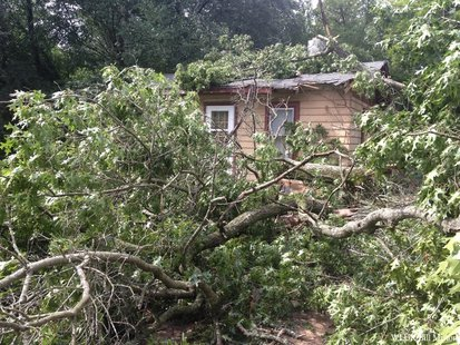 Wednesday evening storms leave Menominee County residents to clean up the mess. A portion of a tree lays across a home and driveway off of County Highway 47 in Keshena in Menominee County. (Photo by: FOX 11).