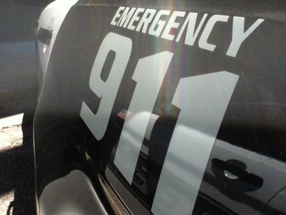 Squad Car 911 sign