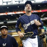 Milwaukee Brewers' Ryan Braun runs onto the field for warm ups before opening day of baseball season as the Brewers take on the Colorado Roc