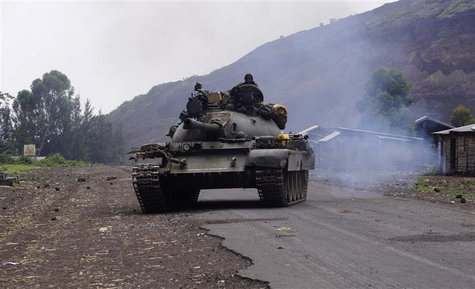 A Congolese government military tank patrols in Kanyarucinya village in the outskirts of Goma in the eastern Democratic Republic of Congo, A