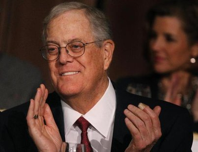 David Koch, executive vice president of Koch Industries, applauds during an Economic Club of New York event in New York, December 10, 2012.