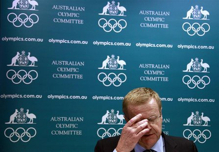 John Coates, President of the Australian Olympic Committee (AOC), reacts as he announces the findings of a probe into the conduct of Austral
