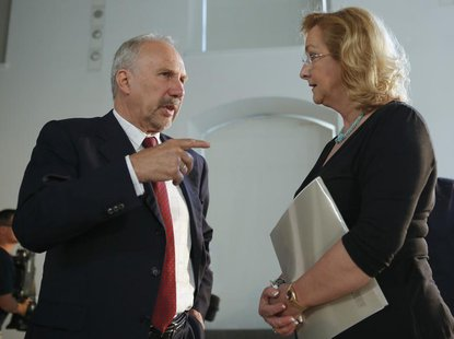 Austrian National Bank (OeNB) Governor and ECB Governing Council member Ewald Nowotny talks to Austrian Finance Minister Maria Fekter prior