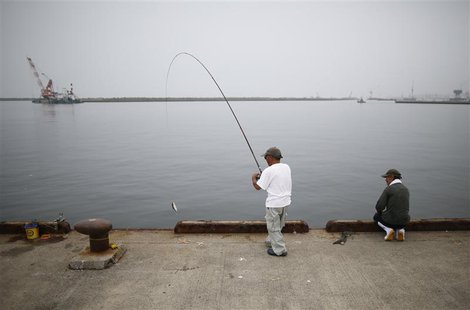 Local residents fish at Onahama port in Iwaki, about 61 km (38 miles) south of the tsunami-crippled Fukushima Daiichi nuclear power plant, F