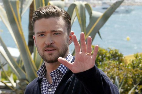 Cast member Justin Timberlake leaves after a photocall for the film 'Inside Llewyn Davis' during the 66th Cannes Film Festival in Cannes May